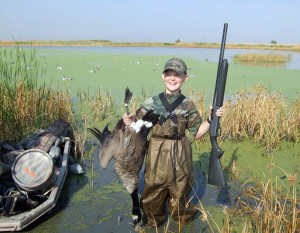 A young hunter shows the goose he took during a guided youth hunt, location unspecified, September 22, 2012 | Photo by Keith Fullencamp, St. George News