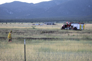 Fire responders work to mop-up a brush fire that burned 2 to 3 acres of grass, New Harmony, UT, June 20, 2015 | Photo by Nataly Burdick, St. George News