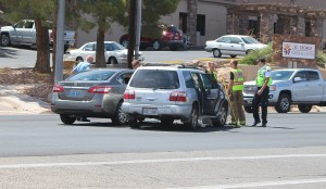 A two-car accident on Bluff Street caused by one car running a red light, St. George, Utah, July 9, 2015 | Photo by Ric Wayman, St. George News