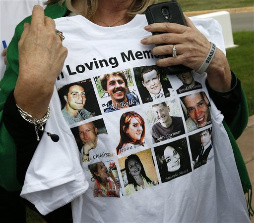 Sandy Phillips, whose daughter Jessica Ghawi was killed in the 2012 Aurora movie theatre massacre, carries a T-shirt memorializing the twelve people killed in the attack, outside the Arapahoe County District Court following the day of closing arguments in the trial of theater shootings defendant James Holmes, in Centennial, Colo., Tuesday July 14, 2015 | AP Photo/Brennan Linsley; St.George News