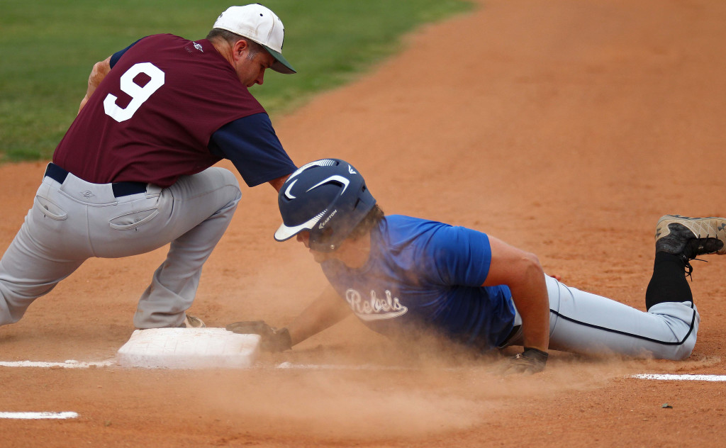 Craig Zimmerman applies the tag on a pickoff play at first base Monday night, Utah Adult Amateur Baseball League all-star game at Elks Field, St. George, Utah, July 6, 2015, | Photo by Robert Hoppie, ASPpix.com, St. George News