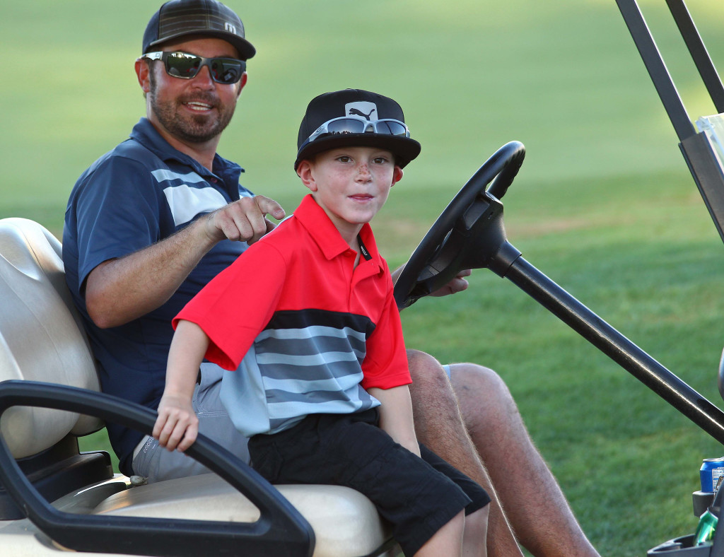 Briggs Filmore (red shirt) and Bret Smith partner up for this tournament, City of St. George JAG summer golf tournament, St. George, Utah, July 16, 2015, | Photo by Robert Hoppie, ASPpix.com, St. George News