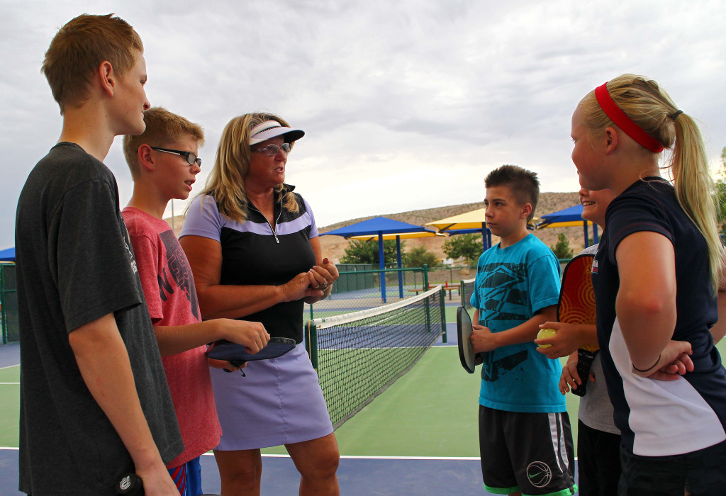 Trish Loghry gives the players some last minute instructions before their matches, City of St. George youth pickleball,  St. George, Utah, July 30, 2015, | Photo by Robert Hoppie, ASPpix.com, St. George News
