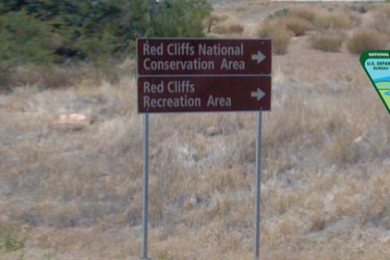 Background photo: Sign for Red Cliffs National Recreation Area near Leeds, Utah, not dated | File photo altered for composite, St. George News