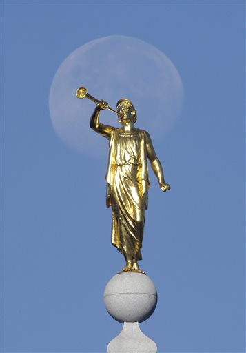 """The angel Moroni statue sits atop the Salt Lake Temple, at Temple Square, in Salt Lake City. The biting satirical musical the """"Book of Mormon"""" that mocks Mormons is finally coming to the heart of Mormonlandia, starting a sold-out, two week run on Tuesday, July 28, 2015, at a Salt Lake City theater two blocks from the church's flagship temple and headquarters, Salt Lake City, Utah, Sept. 11, 2014 