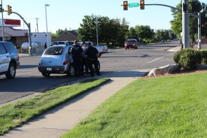 Cedar City Police officers respond to a vehicle-versus-bicycle accident on 200 North in Cedar City, Utah, July 28, 2015 | Photo by Carin Miller, St. George News