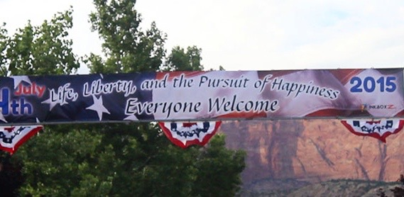 A banner hangs over the entrance to Colorado City's Independence Day celebration, Colorado City, Arizona, July 4, 2015 | Photo by Nataly Burdick