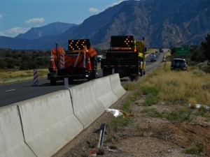 A semitruck lies on its side straddling a culvert near the Toquerville Exit on Interstate 15 northbound, Toquerville, Utah, July 22, 2015 | Photo by Julie Applegate, St. George News