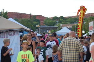 """People pack the street as they stroll past vendors during """"George Streetfest"""" on Main Street, St. George, Utah, July 3, 2015 