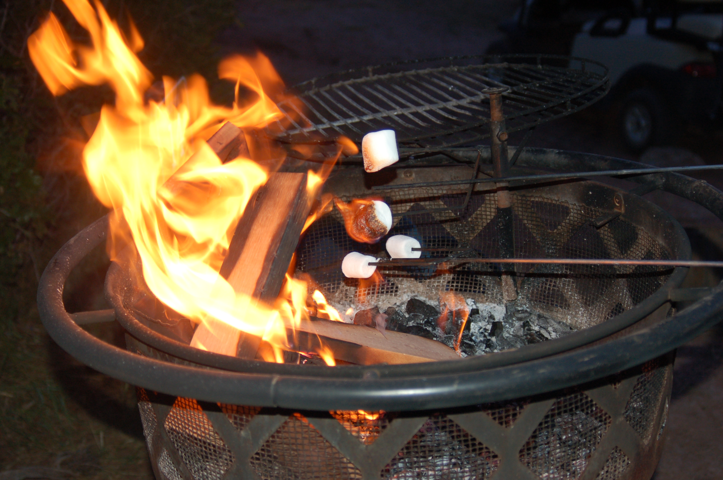 Roasting Marshmallows Over A Contained Fire Pit At Zion Ponderosa Ranch Resort Utah July