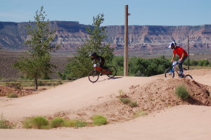 Connor and Lance Clifford zip around the track at the Virgin BMX Track, Virgin, Utah, July 13, 2015 | Photo by Hollie Reina, St. George News