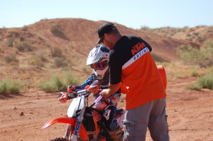 Carson Hamblin (L) and his dad, Aaron Hamblin pause during a practice session to refuel, Warner Valley, Washington City, Utah, July 17, 2015 | Photo by Hollie Reina, St. George News