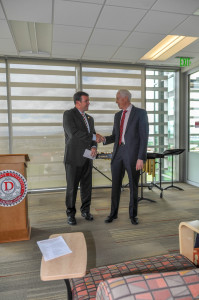 President Richard B. Williams accepts a $25,000 endowment check for the scholarship fund from Jordan Tanner, St. Geogre Utah, July 20, 2015 | Photo courtesy of Dixie State University, St. George News