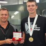 """L-R: DXATC CNC machining instructor Mike Shrout, DXATC and Dixie High School student Thomas """"Ike"""" Urquhart at the DXATC campus in St. George shortly after returning from Kentucky with the SKILLS USA National Gold Medal. St. George, Utah, July 2, 2015 