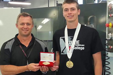 "L-R: DXATC CNC machining instructor Mike Shrout, DXATC and Dixie High School student Thomas ""Ike"" Urquhart at the DXATC campus in St. George shortly after returning from Kentucky with the SKILLS USA National Gold Medal. St. George, Utah, July 2, 2015 