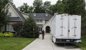 Federal authorities walk into the home of Subway restaurant spokesman Jared Fogle, Tuesday, July 7, 2015, in Zionsville, Ind. FBI agents and Indiana State Police have removed electronics from the property. FBI Special agent Wendy Osborne said Tuesday that the FBI was conducting an investigation in the Zionsville area but wouldn't confirm it involved Fogle, Zionville, Indiana, July 7, 3015 | AP Photo by Michael Conroy, St. George News