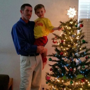 """Greg Palmer, pictured with his son John, has been missing since July 11, 2015, date and location of photo not specified 