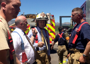 Firemen gather at the home of New Harmony residents Thayne and Vivkie Colvin had a housefire Thursday that ravaged their home, 1006 S. Harmony Point Drive, New Harmony, Utah, July 09, 2015 | Photo by Carin Miller, St. George News