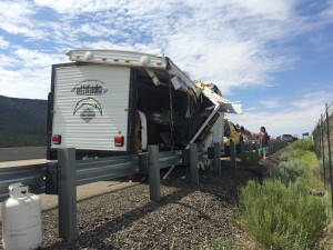 The remains of a trailer that flipped on I-15, spilling it's contents into the roadway, Washington County, milepost 36, July 6, 2015 | Photo by Devan Chavez, St. George News