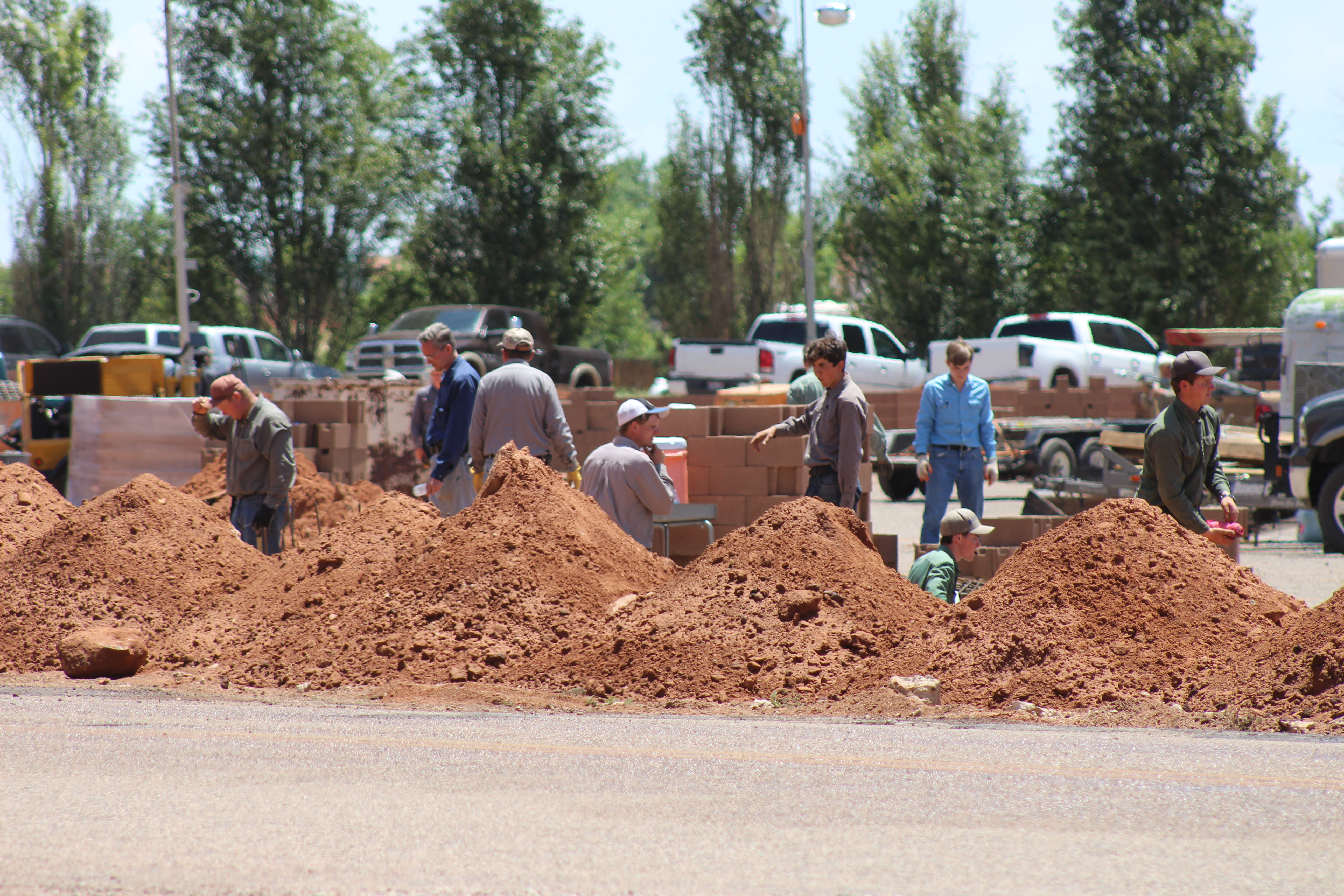FILE — In this file photo, members of the FLDS church work to build a wall around the Leroy S. Johnson Meeting House, Colorado City, Arizona, July 2, 2015 | Photo by Nataly Burdick, St. George News