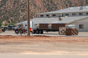 A truckload of blocks is delivered to build a wall around the Leroy S. Johnson Meeting House, Colorado City, Arizona, July 2, 2015 | Photo by Nataly Burdick, St. George News
