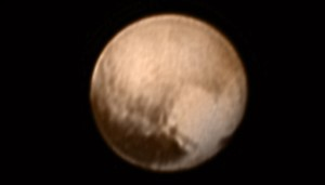 This image  made available by NASA/Johns Hopkins University Applied Physics Laboratory/Southwest Research Institute shows Pluto from the New Horizons' Long Range Reconnaissance Imager (LORRI) combined with lower-resolution color information from the spacecraft's Ralph instrument. Received on July 8, 2015 | Photo by NASA/JHUAPL/SWRI, courtesy of Associated Press, St. George News