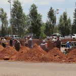 Members of the FLDS church work to build a wall around the Leroy S. Johnson Meeting House, Colorado City, Arizona, July 2, 2015   Photo by Nataly Burdick, St. George News
