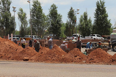 Members of the FLDS church work to build a wall around the Leroy S. Johnson Meeting House, Colorado City, Arizona, July 2, 2015 | Photo by Nataly Burdick, St. George News