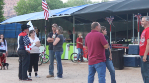 Attendees chat and catch up during the Fourth of July festivities, Colorado City, Arizona, July 4, 2015 | Photo by Nataly Burdick