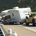 A tow truck prepares to remove the wreckage of a trailer that flipped on I-15 near milepost 36, spilling its contents into the roadway, Washington County, Utah, July 6, 2015 | Photo by Devan Chavez, St. George News