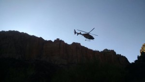 A Classic Lifeguard helicopter carries an injured woman to the hospital, Water Canyon, near Hildale, Utah, July 28, 2015 | Photo courtesy of Washington County Search and Rescue, St. George News