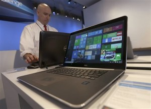 In this April 29, 2015, file photo, a Dell laptop computer running Windows 10 is on display at the Microsoft Build conference in San Francisco. Microsoft's new Windows 10 operating system debuts Wednesday, July 29, 2015, as the longtime leader in PC software struggles to carve out a new role in a world where people increasingly rely on smartphones, tablets and information stored online. Location not given, April 29, 2015 | AP Photo/Jeff Chiu, File; photo extended and left and right ends for sizing; St. George News