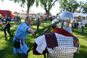 Fred Govedich, left, of the Dominion of Capella, and Aaron Orton, of Black Company, engage in a mock battle at the Utah Midsummer Renaissance Faire, Cedar City, Utah, July 12, 2014 | Photo by Cami Cox Jim, St. George News