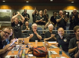 Members of the New Horizons science team react to seeing the spacecraft's last and sharpest image of Pluto before closest approach later in the day at the Johns Hopkins University Applied Physics Laboratory (APL) in Laurel, Maryland. NASA's New Horizons spacecraft was on track to zoom within 7,800 miles (12,500 kilometers) of Pluto,  Johns Hopkins University Applied Physics Laboratory,  Laurel, Maryland, Tuesday, July 14, 2015 | Photo by Bill Ingalls NASA via AP, St. George News