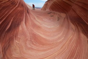 In this file photo, a hiker walks on a rock formation known as The Wave in the Vermilion Cliffs National Monument in Arizona. The richly colored geological upheaval along the Arizona-Utah border is one of the most sought-after hikes in the West. But the Wave isn't without dangers that led officials with the U.S. Bureau of Land Management to implement a series of safety measures following a trio of deaths in 2013. A new proposal to change the way permits are doled out and increase fees also could free up more people to do safety checks. Paria Canyon-Vermilion Cliffs National Monument, Utah-Arizona, May 28, 2013 | AP Photo/Brian Witte, File, St. George News