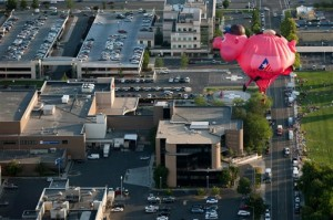 The Bank of American Fork piggy bank balloon flies through the air before crash landing near Utah Valley Regional Medical Center during America's Freedom Festival Balloon Fest in Provo, Utah, Thursday, July 2, 2015, |Photo by Grant Hindsley/The Daily Herald via AP, St. George News
