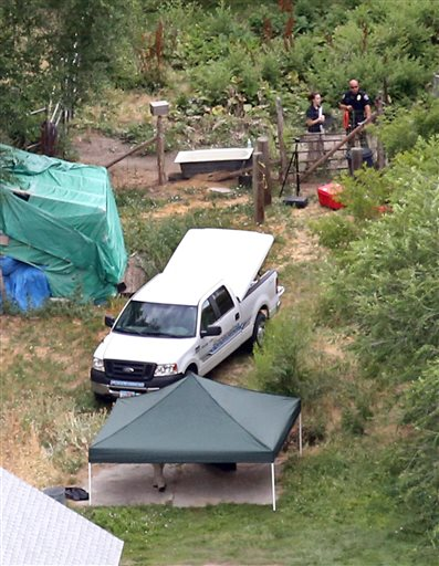 In this aerial photo, investigators look for evidence in the field where the body of a 12-year-old girl found on Friday , July 17, 2015, in West Valley City, Utah.   Police believe she was killed in an altercation in the field near where her body was found in the suburb of Salt Lake City, West Valley City, July 17, 2015 | AP photo by Tom Smart,The Deseret News, St. George News