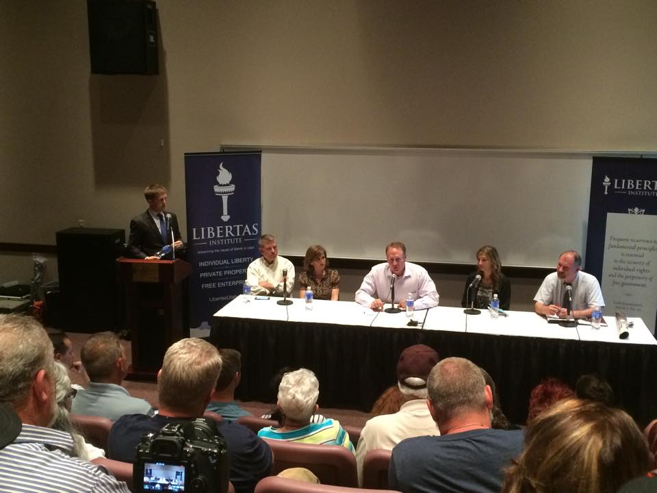 L-R from podium: Connor Boyack, president Libertas Institute; Dr. Mike Wilson; Jenny Wilson; Utah Sen. Mark Madsen; Christine Stenquist, director of Drug Policy Project of Utah; and David Doddridge, former narcotics officer. Medical Cannabis Forum hosted by Libertas Institute, at the Dixie Center St. George, St. George, Utah, July 16, 2015 | Photo by Hollie Reina, St. George News