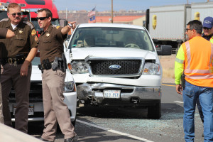 Utah Highway Patrol Sgt. Danny Ferguson had his second close call in the last year when a minivan crashed into a truck just feet from where he stood, St. George, Utah, July 31, 2015 | Photo by Nataly Burdick, St. George News