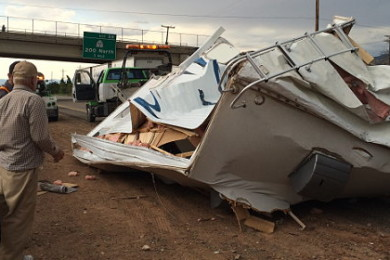 Northbound I-15 at milepost 58 in Cedar City was stalled by the rollover of a pickup truck and trailer. No injuries were reported, Cedar City, Utah, July 2, 2015 | Photo by Carin Miller, Cedar City News