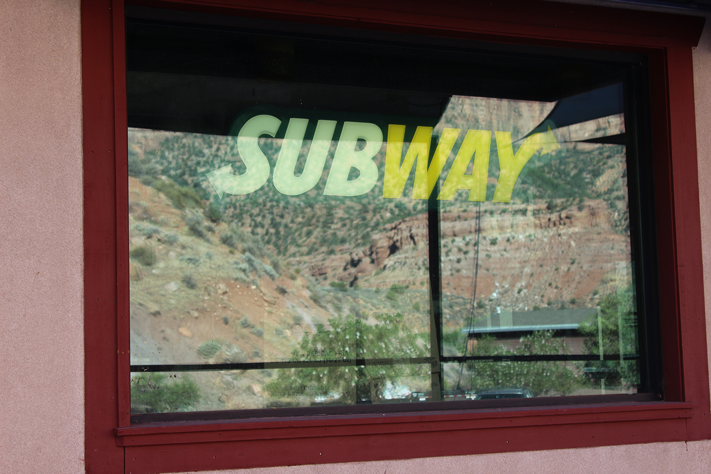A Subway sign in the window of Izzy Poco, which now might be able to open, Springdale, Utah, July 17, 2015 | Photo by Nataly Burdick, St. George News