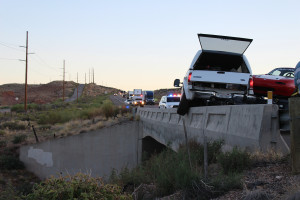 A truck hauling two Mazda Miatas was pushed onto a concrete barrier on a bridge after the trailer carrying the Miatas began to whip and the driver lost control of the truck and trailer, Leeds, Utah, July 28, 2015 | Photo by Nataly Burdick, St. George News