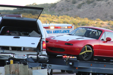 A truck hauling two Mazda Miatas was pushed onto the concrete barrier of a bridge after the driver lost control of the truck and trailer, Leeds, Utah, July 28, 2015 | Photo by Nataly Burdick, St. George News