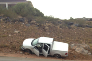 A driver lost control of his truck and ran into a ridge on Foremaster Drive, July 18, 2015, St. George, Utah | Photo by Brittney Chubbs, St. George News