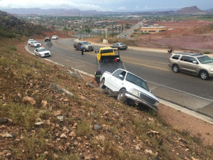 A driver loses control of his truck and runs into an embankment on Foremaster Drive, St. George, Utah, July 18, 2015 | Photo by Michael Durrant, St. George News