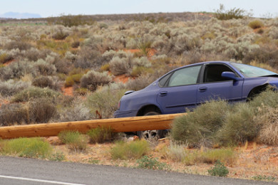 A car hits a power pole on Sand Hollow Road, taking down the pole and a power line, Hurricane, Utah, July 3, 2015 | Photo by Nataly Burdick, St. George News
