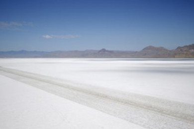 An aerial view of the Bonneville Salt Flats in Utah. A small city of tents, trailers and thousands of visitors appears almost every August in the Utah desert to watch cars, motorcycles and anything with wheels rocket across gleaming white sheets of salt at speeds of 400 mph. But wet weather has forced the cancellation of Speed Week for the second straight year and revived a debate about whether nearby mining is depleting the Bonneville Salt Flats of their precious resource, Wendover, Utah, July 22, 2015 | AP Photo by Rick Bowmer, St. George News
