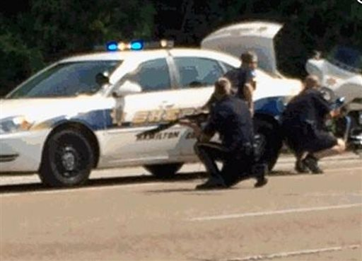 In this image made from video and released by WRCB-TV, authorities work an active shooting scene on amincola highway near the Naval Reserve Center. Chattanooga Mayor Andy Berke says police are pursuing an active shooter after reports of a shooting at the military reserve center, Chattanooga, Tenn., July 16, 2015 | Photo courtesy of WRCB via AP, St. George News