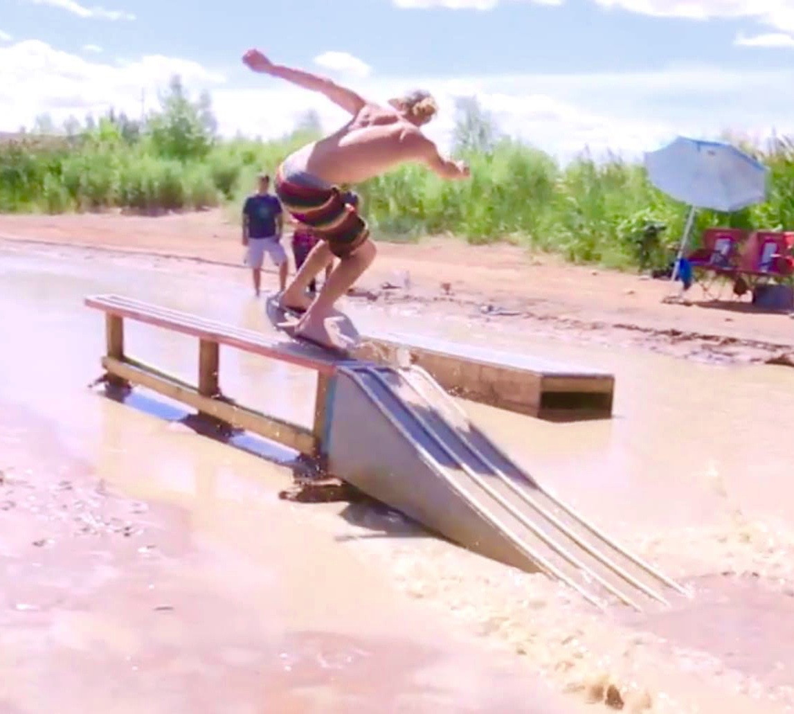 Skimboarders compete at 2015 Virgin River Skimboard Classic, at what is locally known as the waterfall in the Virgin River by the intersection of 2700 East and Waterfront Drive, St. George, Utah, July 11, 2015 | Photo by Sheldon Demke, St. George News