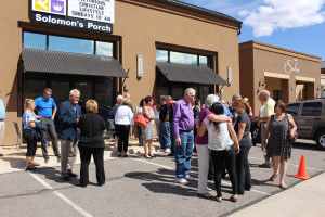 Members and friends of the Solomon's Porch church mingle during the ribbon cutting ceremony, St. George, Utah, July 9, 2015 | Photo by Nataly Burdick, St. George News